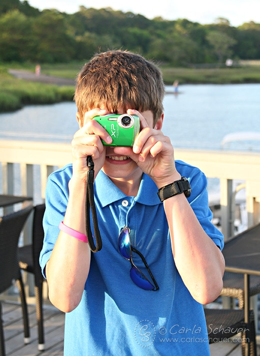 Tweens love to take photos, and are at a great age to have their own cameras. Great tween travel tips at Meander & Coast