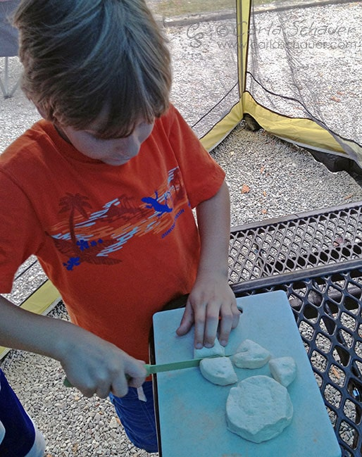 Making monkey bread over the campfire. Campground cooking is great for tweens and teens. | Meander & Coast