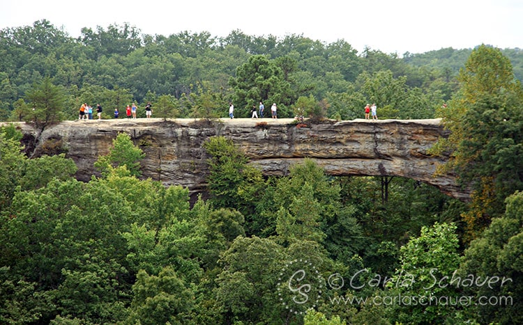 Hiking over Natural Bridge in Kentucky. Hikes are fun camping activities for tweens and teens.| Meander & Coast Travel