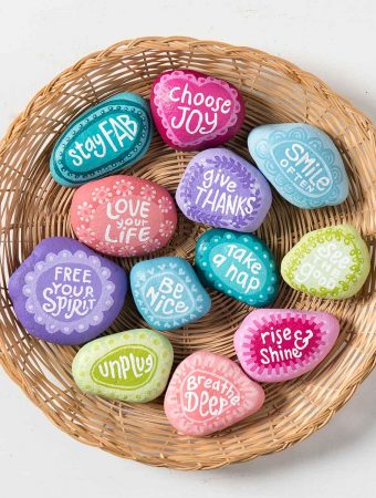 Make Inspirational painted rocks. Would be a fun activity for teens. | Easy outdoor rock crafts to take camping. | Meander & Coast #inspirationalrocks #paintedrocks #wordart #rocksforoutdoors #rockart #outdoorcrafts #teencrafts #campcrafts #camping #rockpainting