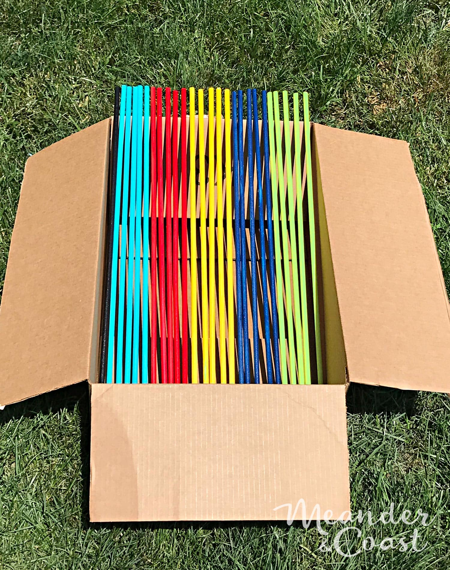 Make giant pick up sticks with paint and wooden dowels. Tutorial from MeanderAndCoast.com. #pickupsticks #giantgames #yardgames #giantoutdoorgame #campinggames #outdooractivities