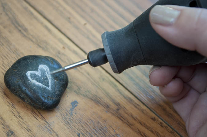 I love this idea! Carve rocks using a Dremel Tool. | Outdoor rock crafts to take camping. | Meander & Coast #inspirationalrocks #paintedrocks #wordart #rocksforoutdoors #rockart #outdoorcrafts #teencrafts #campcrafts #camping #rockpainting