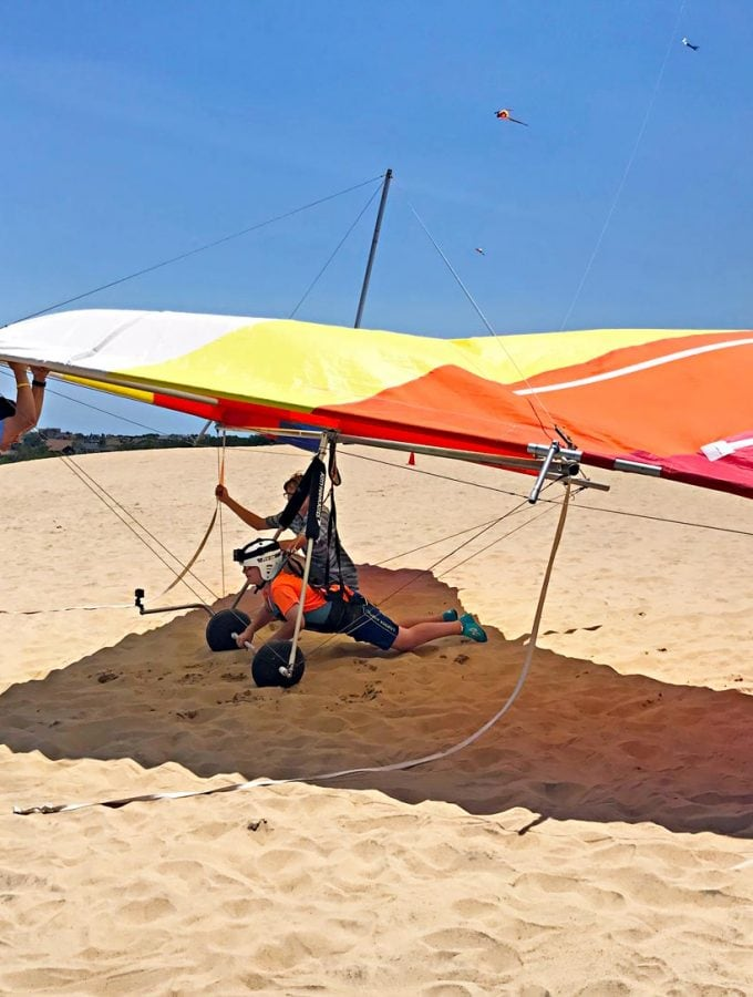 This looks like so much fun! Dune hang gliding lesson at Jockey's Ridge State Park, NC. | Meander & Coast #hanggliding #dunehanggliding #hangglidinglessons #flyinglessons #outerbanks #nagshead #kittyhawk #northcarolina #familyvacation #travel #adventure #teentravel #familytravel
