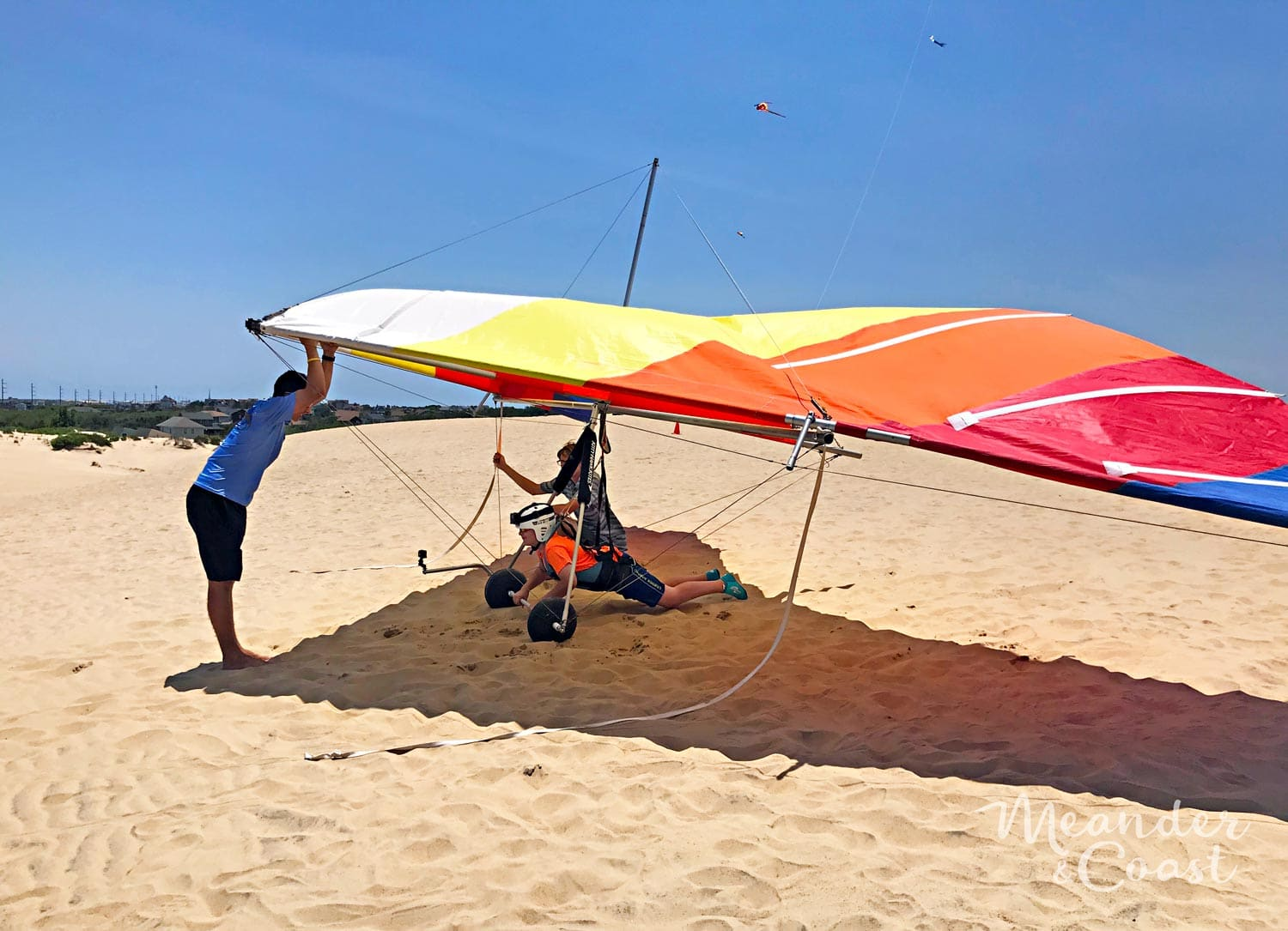 This looks like so much fun! Outer Banks hang gliding lesson at Jockey's Ridge State Park, NC. | Meander & Coast #hanggliding #dunehanggliding #hangglidinglessons #flyinglessons #outerbanks #nagshead #kittyhawk #northcarolina #familyvacation #travel #adventure #teentravel #familytravel