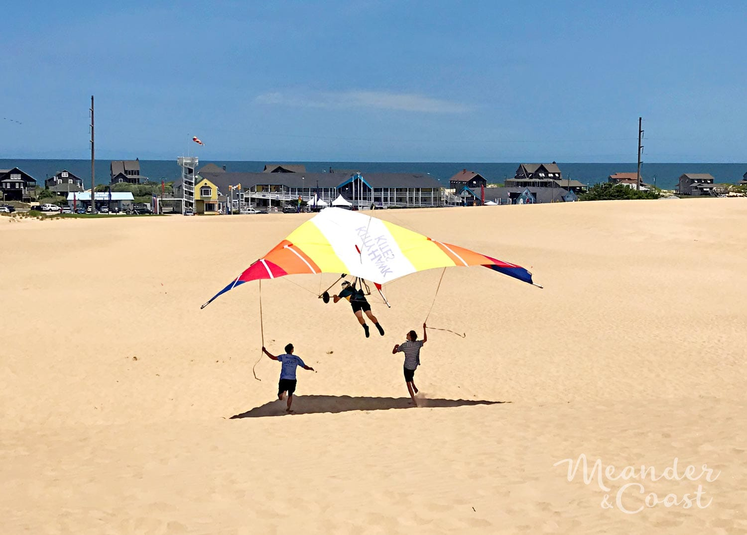 This looks amazing! Dune hang gliding lesson at Jockey's Ridge State Park, NC. | Meander & Coast #hanggliding #dunehanggliding #hangglidinglessons #flyinglessons #outerbanks #nagshead #kittyhawk #northcarolina #familyvacation #travel #adventure #teentravel #familytravel