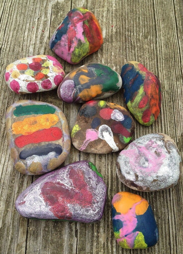 Make melted crayon rocks in the campfire. Camping craft ideas from Meander & Coast. #meltedcrayonrocks #campingcrafts #rockartideas #paintedrocks #rockcrafts #campcrafts #crayoncraft